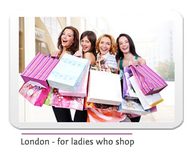 4 happy ladies with shopping bags